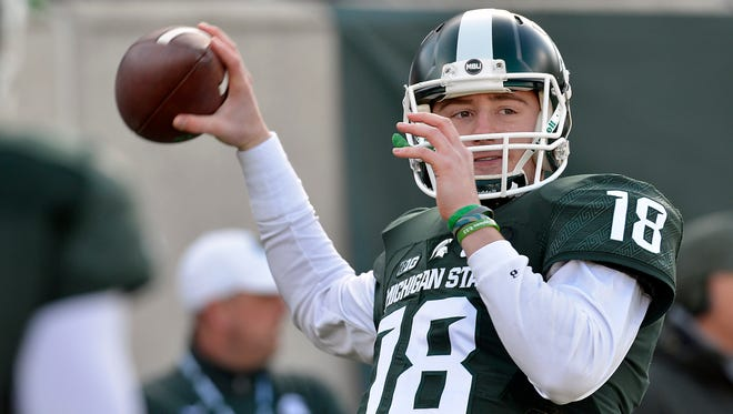 MSU starting quarterback Connor Cook warms up before MSU hosts Penn State Saturday.