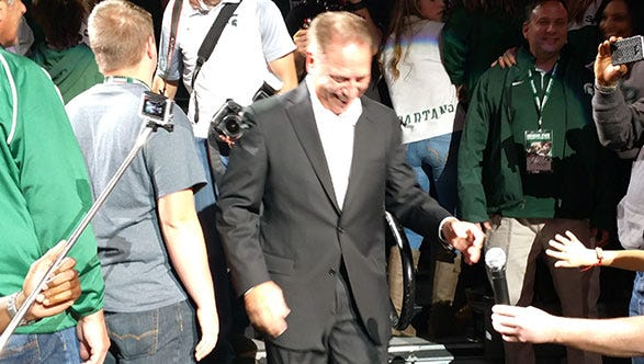 Michigan State coach Tom Izzo makes his entrance during Midnight Madness at the Breslin Center Friday.