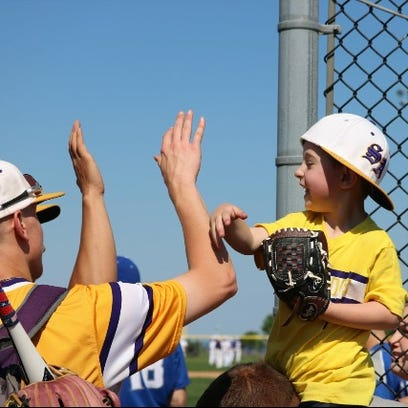 Michael Grzankowski high fives South Amboy players