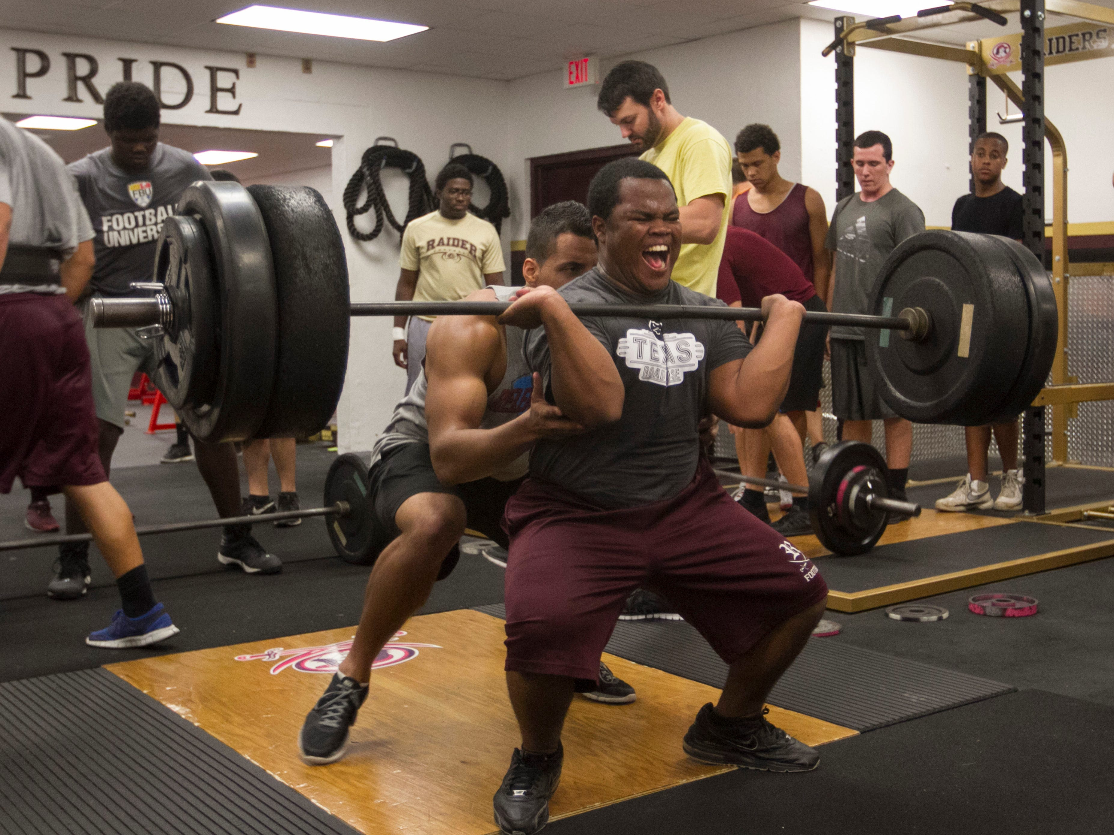 David Cummings works out in the weight room at Riverdale High School .