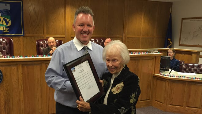 Lyon County Commissioner Ray Fierro presents Kay Winters with a copy of the proclamation after the commission proclaimed Dec. 3, 2015, as Kay Winters Day in honor of her contributions to the county throughout the years.