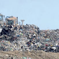 Bulldozers move a recent deposit of trash at the Big Run landfill. It was envisioned as a cash cow for Boyd County, which made a deal to accept hundreds of thousands of tons of out-of-state trash for about $1 million a year.