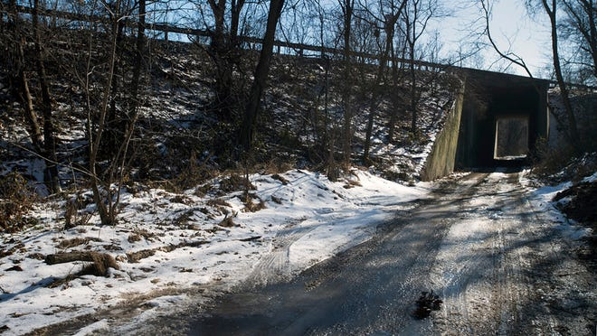 Looking south through the abandoned railroad tunnel beneath Interstate 83.   Paul Kuehnel - Daily Record/Sunday News