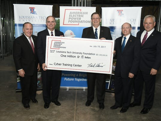 636360717337846422-AEP-Foundation-Check-Presentation---Louisiana-Tech.jpeg