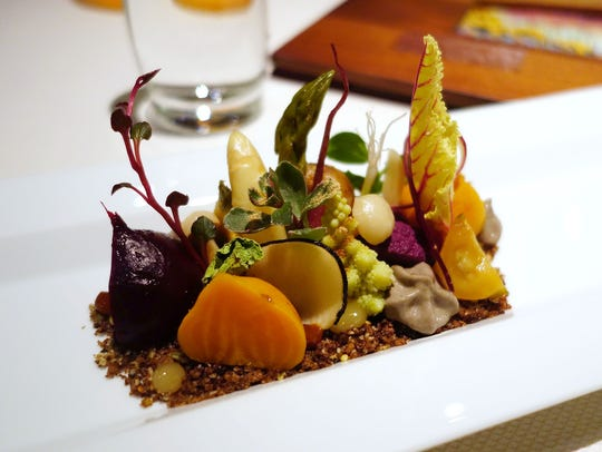 Kai's Preserved Garden is made with pickled roots, confit of Rose Gold potatoes, fermented earth, dried cactus pads, chanterelle mushrooms and saguaro mist.