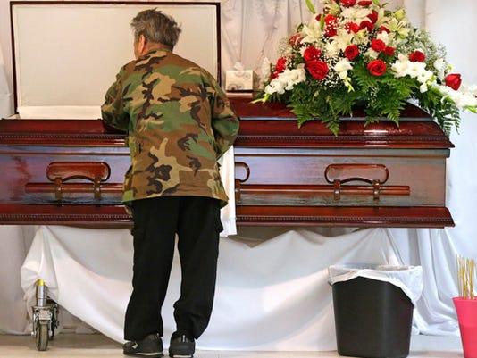 triple_homicide_funeral.jpg