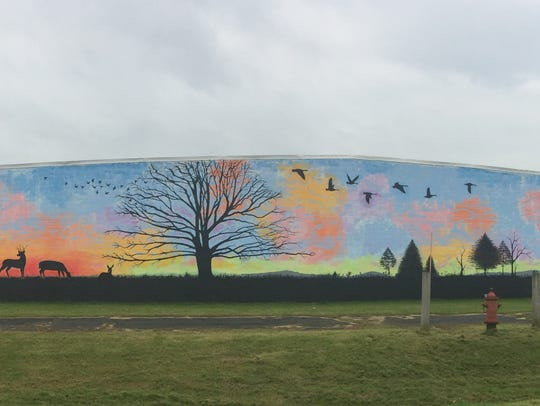 A panoramic view of a mural painted by Chenango Valley