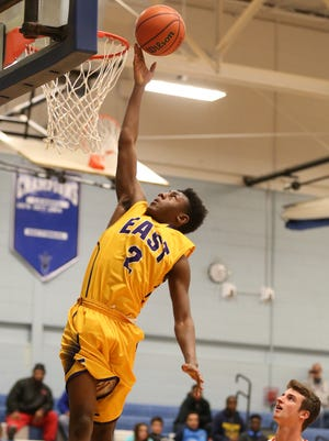 East's Darrell Barley lays in two during their opening game of the Doug Westcott Memorial Basketball Tournament Monday, Dec. 28, 2015 in Brockport.  East won the game 77-55.  The finals will be held Wednesday, Dec. 30, at 6 pm, with the consolations game at 4.
