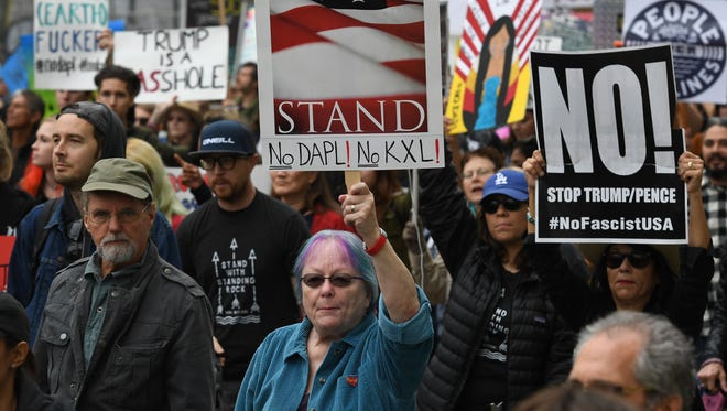 Demonstrators march to the Federal Building in protest against US President Donald Trump's executive order fast-tracking the Keystone XL and Dakota Access oil pipelines, in Los Angeles, California on February 5, 2017. Trump has revived two pipeline projects blocked by his predecessor on environmental grounds, signaling his determination to undo Barack Obama's legacy.