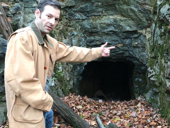Explorer Dan Lopez discusses an abandoned mine tunnel