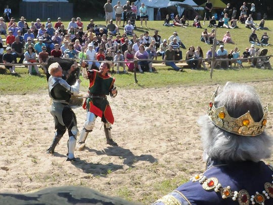 Sir William (Bill Burch of Hillsboro), left, and Sir Joseph (Joe Darrigo of Brockton, Mass.) battle in front of the king in a jousting match that started on horses at last year's Door County Renaissance Faire.