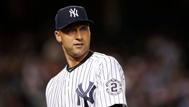 New York Yankees shortstop Derek Jeter returns to the dugout between innings on Sept. 9, 2014.