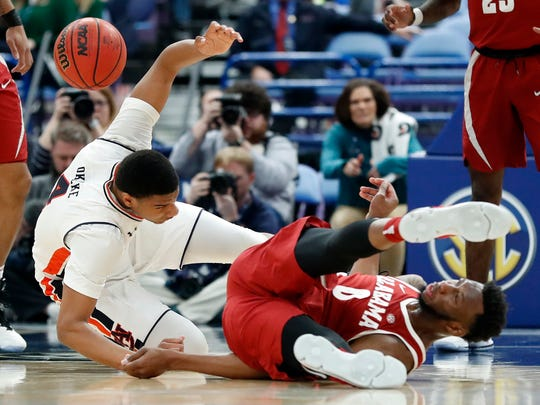 Alabama's Donta Hall, right, flips over Auburn's Chuma Okeke during the second half in an NCAA college basketball quarterfinal game at the Southeastern Conference tournament Friday, March 9, 2018, in St. Louis. Alabama won 81-63. (AP Photo/Jeff Roberson)