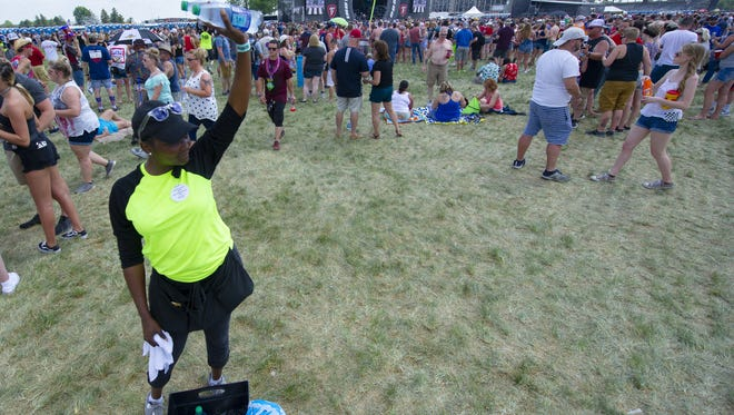 Laquadra Freeman sells bottles of water to fans trying to beat the heat of the afternoon during the Firestone Legends Day Concert.