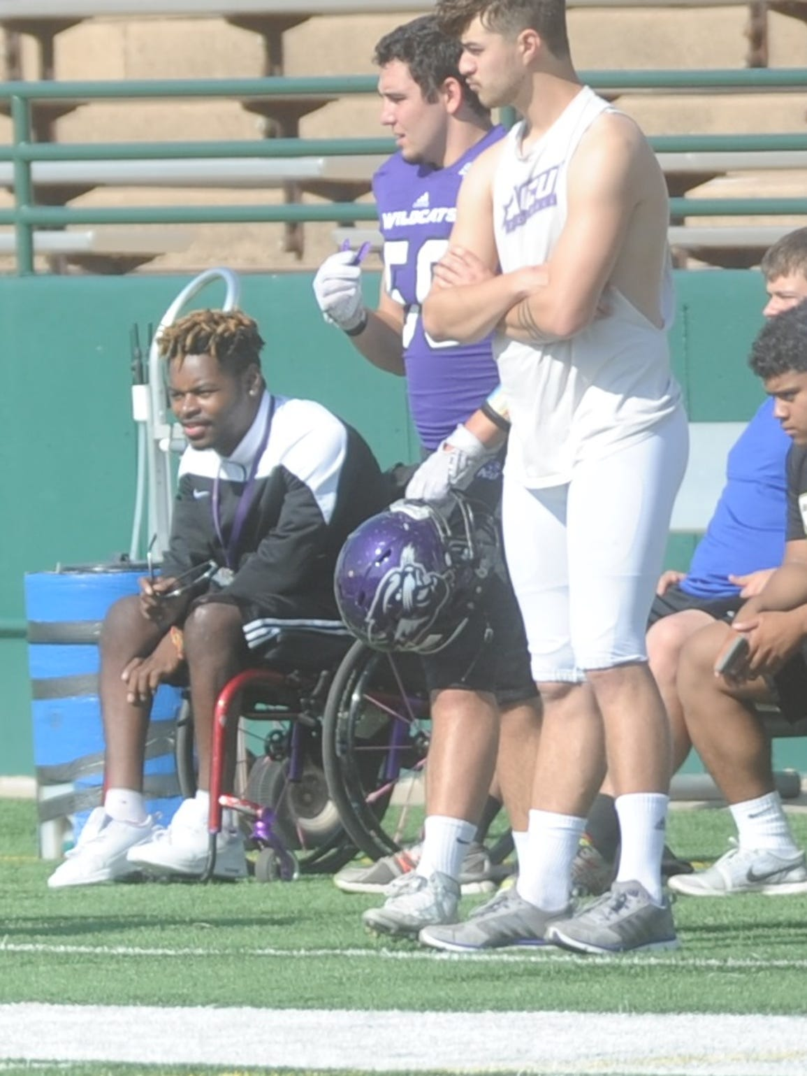 J.R. Hall, left, watches from the sidelines during