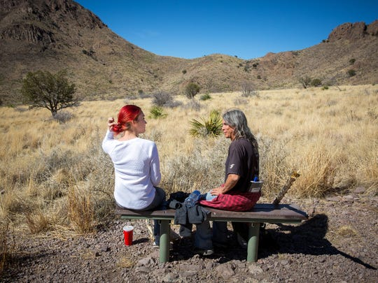 Desarae Lopez and Chipper Posey take a break while hiking in the Bureau of Land Management's Soledad Canyon Day Use Area.