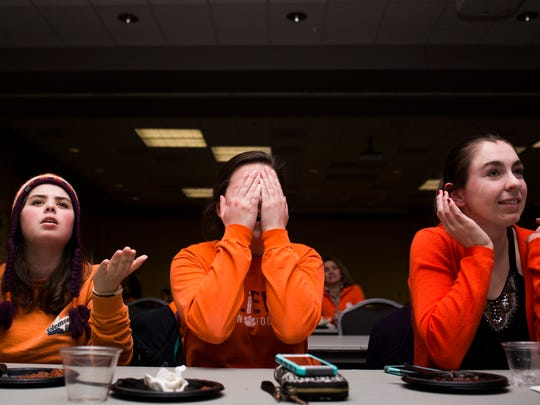 Clemson sophomores Christina Phillips, Bekah Payne, and Emily Huffer react to Alabama scoring a touchdown while watching the national championship game on Monday at the Hendrix Student Center on campus.