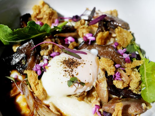 Aux Bar's pheasant small plate comes with Carolina rice porridge, wild mushroom, smoked jus, soft egg and cracklings.