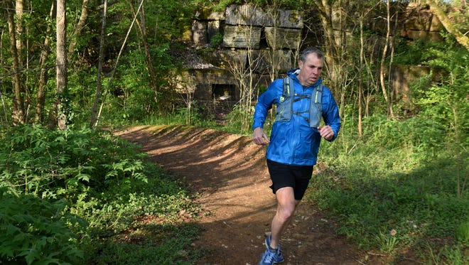 Brian Winter running on a trail at Ijams in South Knoxville Tuesday, April 17, 2018. Winter, a Knoxville resident, recently completed the international marathon challenge running seven marathons on seven continents in seven days.