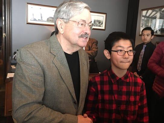 U.S. Ambassador to China Terry Branstad shook hands