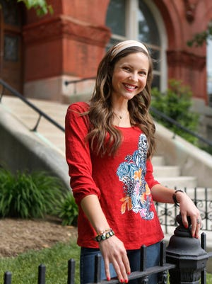 C-J Stylemaker Meghan Shaughnessy is seen at the entrance of Presentation Academy, where she teaches science.