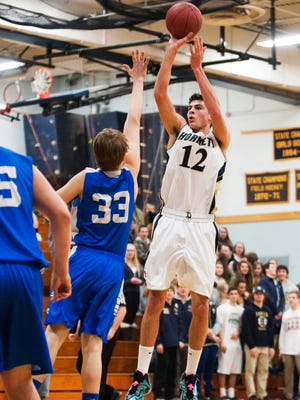 Essex's Eli DiGrande (12) takes a jump shot during a boys basketball game against Missisquoi in February.