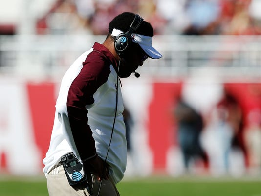 Texas A&M head coach Kevin Sumlin bows his head during the first half of an NCAA college football game against Alabama, Saturday, Oct. 22, 2016, in Tuscaloosa, Ala. (AP Photo/Brynn Anderson)