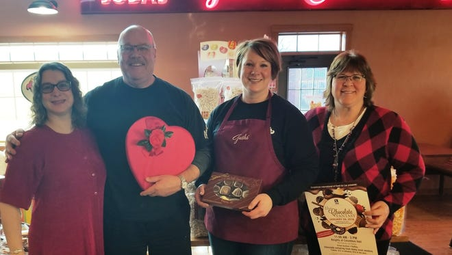 Taking a break from preparations for the Soroptimists of Fond du Lac's 22nd Annual Chocolate Fantasy at Guth's End of the Trail Candy Shoppe in Waupun are, from left, Chocolate Fantasy event co-chair Linda Uselmann, owner Steve Guth, his daughter Katie Bohn and co-chair Kathy Shafer. Boxes of Guth's chocolates are being sold now and at the event that include a raffle ticket to win a diamond ring from The Goldsmith valued at $4,500.