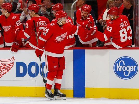 Detroit Red Wings' Gustav Nyquist (14) celebrates his goal against the Winnipeg Jets in the first period of an NHL hockey game Tuesday, Dec. 5, 2017, in Detroit. (AP Photo/Paul Sancya)