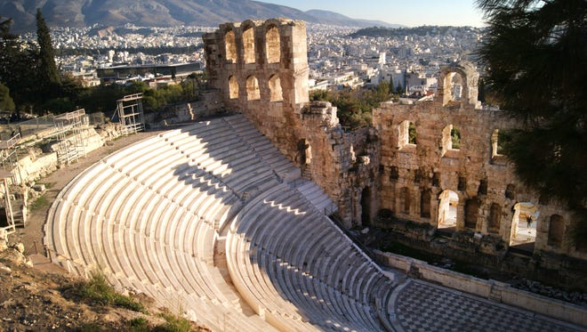 The Odeon of Herodes Atticus, or Herodeon, a stone theatre structure located on the southwest slope of the Acropolis of Athens, is seen against a backdrop of Athens on Dec. 11, 2016.