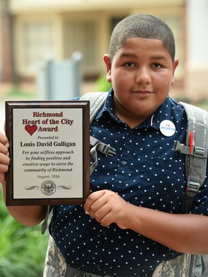 Louie Galligan, 13, is honored with the first Heart of the City Award on Wednesday at the Grassroots Action Resource Center on East Main Street in Richmond.