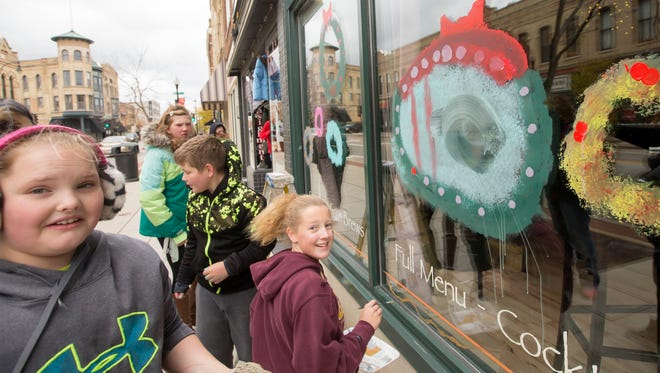 South Park Middle School students paint Whoville scenes on storefront windows in downtown Oshkosh on Monday, Oct. 30, 2017, in preparation of the holiday season.