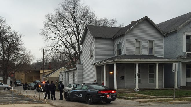 Lafayette police prepare to leave the 200 block of South Fourth Street, where a battery suspect had holed up inside an apartment. Police coaxed him from the apartment and took him to headquarters for questioning. The case is underinvestigation, and no arrests have been made.