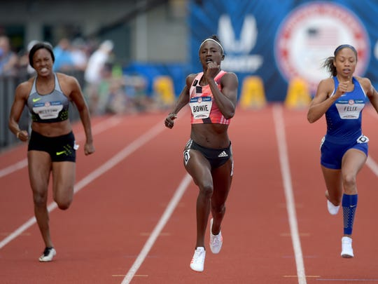 Candyce McGrone (left) and Tori Bowie (middle) and Allyson Felix (right) compete during the women's 200m semifinals in the 2016 U.S. Olympic track and field team trials at Hayward Field.