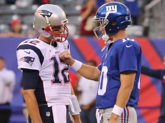 Patriots QB Tom Brady, left, and Giants QB Eli Manning.