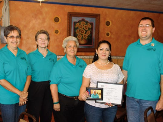 Deming Roadrunners bowler Sean Beginski presented Irma Martinez of Irma's Restaurant with a plaque, a photo and a Deming Special Olympics window decal for sponsoring him during the 2015-16 bowling season. Beginski and his Roadrunner teammates practice at the Starmax Bowling Center on Tuesdays and will be compete at district and state Special Olympic meets. From left are Helen Stratton, Maureen Hill, Adele Moreno, Martinez and Beginski.