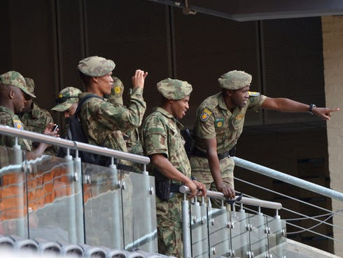 Military police patrol the FNB Stadium on Monday ahead of South African former president Nelson Mandela's memorial service in Johannesburg on Tuesday.