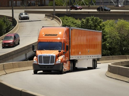 Trailer skirts like the one shown here help improve gas mileage and reduce emissions for Schneider trucks.
