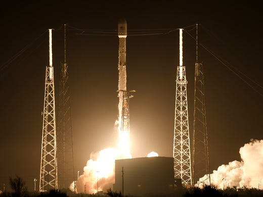 A SpaceX Falcon 9 rocket takes off from Cape Canaveral