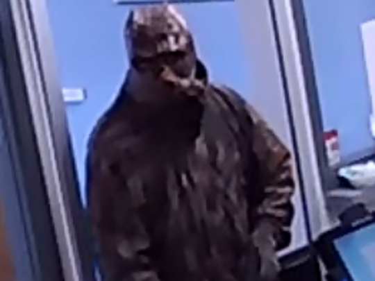 Police are asking for help from the public in identifying this suspect involved in an armed robbery at Magruder Pharmacy.
