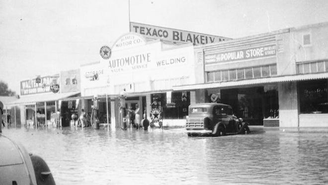 The Blakely Automotive building, the Serrano Popular Store and the Page Market on the left, are shown with the flood of 1938 in the foreground.
