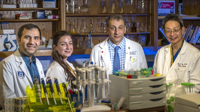 Dr. Hesam Khodadadi, from left, Dr. Evila Salles, Dr. Babak Baban and Dr. Jack Yu photographed in their lab at Medical College of Georgia at Augusta University Wednesday afternoon Sept. 30, 2020 in Augusta, Ga.
