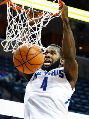 Memphis forward Raynere Thornton finishes a dunk against Albany during second half action at the FedExForum on Saturday, December 12, 2017.