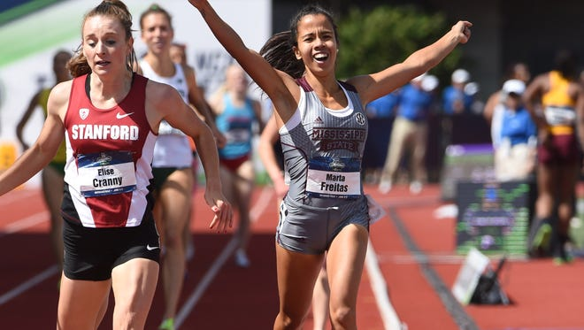 Marta Freitas of Mississippi State celebrates after defeating Elise Cranny of Stanford to win the women's 1,500m, 4:09.53 to 4:09.54, during the 2016 NCAA Track and Field championships last week.