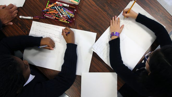 Asbury Park school children will get a leg up on computer coding through a new partnership between Hope Academy and Sprockets. Students draw out a computer coding project on paper during the class.