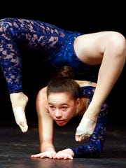 13-year-old Allison Chong of Morris Twp performs acrobatic