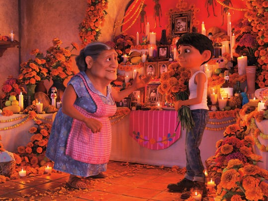 "In ""Coco,"" Miguel and his grandmother prepare for Day of the Dead."