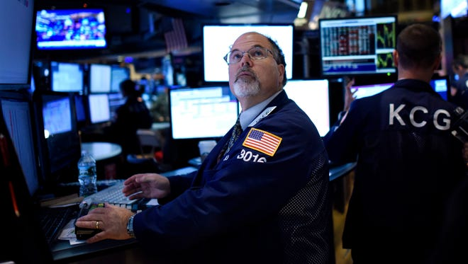 A trader works on the floor of the New York Stock Exchange on Sept. 22, 2015. (EPA/JUSTIN LANE)