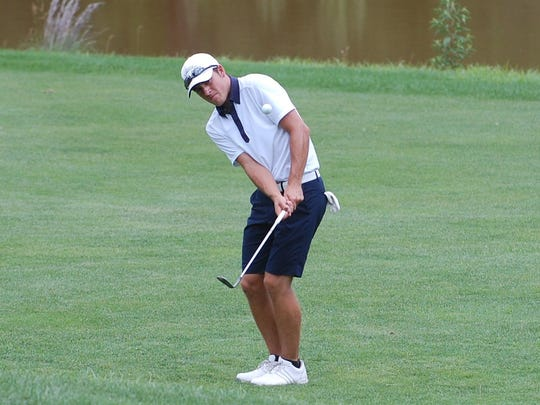 A recent Highland High School graduate, Jake Storako hits a chip shot on to the 17th green during the final round of the Camden County Amateur Golf Tournament.