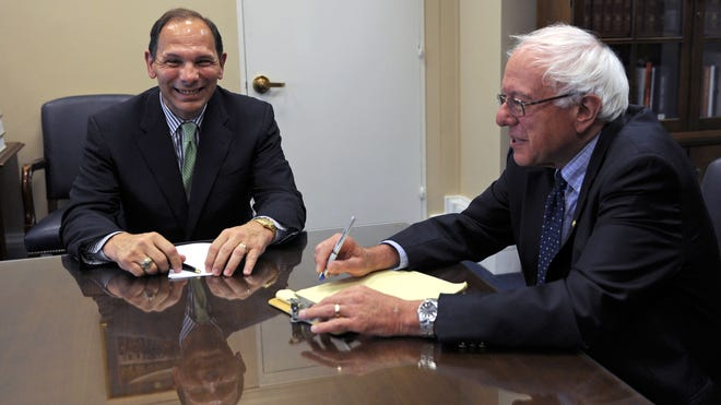 Robert McDonald, left, the new secretary of the Department of Veterans Affairs, meets with Senate Veterans' Affairs Committee Chairman Bernie Sanders, I-Vt., on Capitol Hill in Washington last month.